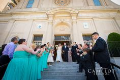 Bride and Groom walking out of Basilica of Regina Pacis