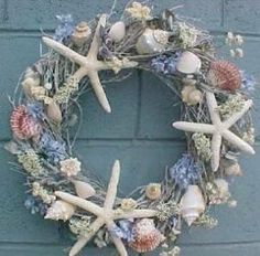 Beach wreath with flowers , sea shells and starfish! Love this for summer or for the Beach house or Coastal cottage! Seashell Wreath, Nautical Wreath, Seashell Art, Seashell Crafts, Beach Crafts, Diy And Crafts, Coastal Wreath, Seashell Ornaments, Snowman Ornaments