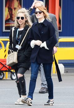 Emma Stone: Pea coat + Tie-neck blouse + Skinny jeans + Oxfords at Disneyland