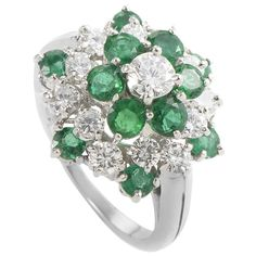 Oscar Heyman Emerald Diamond Platinum Cluster Ring | From a unique collection of vintage cluster rings at http://www.1stdibs.com/jewelry/rings/cluster-rings/