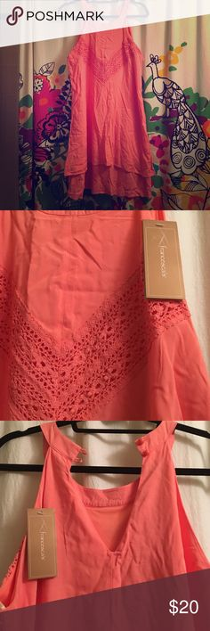 NWT Francesca's dress! Brand new never been worn lace tiered mini dress! Classy and sassy :) coral pink in color, slightly wrinkled but ready to wear in warm weather! Neck closure button is slightly loose but a stitch will keep it in place! Francesca's Collections Dresses