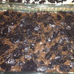 Rice crispy treats with melted chocolate and crushed oreos ~