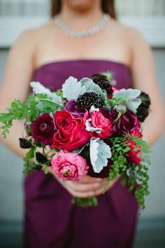 Textured bouquet with shades of red, pink and purple: http://www.stylemepretty.com/2014/08/21/jewel-tone-wedding-moments-to-love/