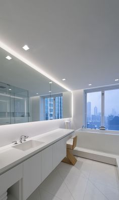 A lighting idea for contempporary bathrooms | Modern LED Lighting For The Bathroom | Aurora Square Edge Bathroom Light - by Pure Lighting