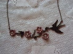 Black and Taupe Necklace Rose and Bird by casselizadesigns on Etsy, $16.00 - very sweet