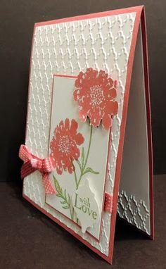 Jonia's lovely card uses Field Flowers set, Fancy Fan embossing folder, & the Mosaic punch.