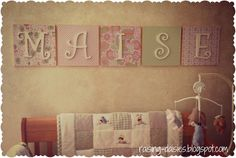 cover canvases with fabric and glue wood letters to it