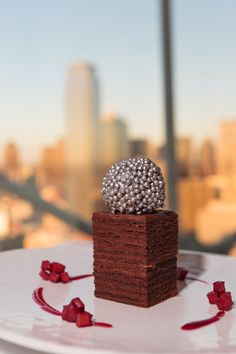 "Our WP Catering pastry chefs get opportunities to be creative, like for the ""Reunion Tower Signature Dessert Contest."" The winner? A chocolate dessert version of the iconic Reunion Tower in Dallas. It's a flourless chocolate cake, with praline mouse in a dark chocolate sphere, finished with white chocolate pearls sprayed with luster."