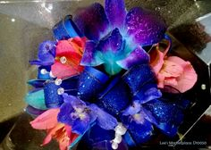 corsage | tie dye blue orchids, pink alstroemeria, blue satin ribbon, blue sheer sparkle ribbon with jewel and pearl accents