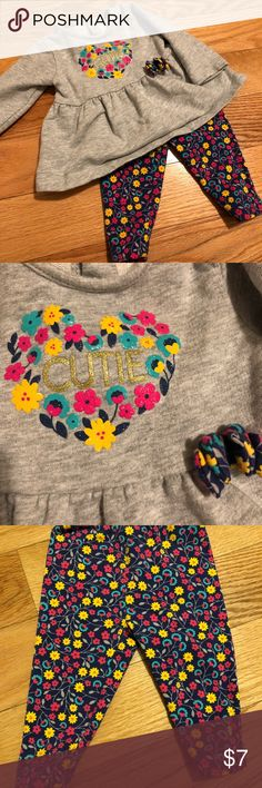 Carter's (Child of Mine)- two piece outfit, 0-3 Carter's (Child of Mine)- two piece outfit, 0-3. Gray shirt with design & multi-colored leggings. Shirt has a raised bow. Washed using free + clear detergent. Smoke free, pet free. Carter's Matching Sets