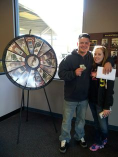 "Kayla Abbott & Travis Foote got to spin the wheel! ""We got the best deal ever! Kirk Brazil is the man and They paid me cash from the wheel of thanks!"" Buy this Prize Wheel at http://PrizeWheel.com/products/floor-prize-wheels/big-40-prize-wheel/."