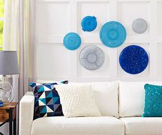 What a cool idea for unused glass pieces one has collected:  Rescue cast-off crystal platters and turn them into one-of-a-kind artwork. Paint the smooth sides of the platters with two to three coats of acrylic paint; let dry between coats. Mix and match colors, sizes, and patterns and hang the platters together in a grouping.