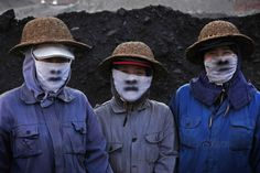 Three women from China work in a mine and show their hard work on masks