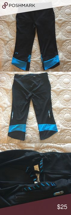 Under Armour crops Black Under Armour crops with bright blue accents. Back zippered pocket, inside drawstring. Under Armour Pants Capris