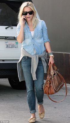 Oh please, it's just a snake!!  Shut up hippees!! Reese Witherspoon caught grief from PETA for carrying a Chloe Paraty python-skin and leather handbag.  Python handbags are illegal in California.
