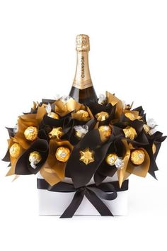 Diy wine n chocolate bouquet Chocolates Ferrero Rocher, Ferrero Rocher Bouquet, Sweet Trees, Wine Gift Baskets, Basket Gift, Champagne Gift Baskets, Champagne Gifts, Candy Gift Baskets, Raffle Baskets
