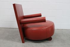 """Gambardella London - A rare B&B Italia """"Sity"""" Easy Armchair. This is the one to have - a piece of art thats surprisingly comfortable and yet a little 'mad' - designed by ANTONIO CITTERIO - all cushioned in red chestnut leather on a steel frame. Gorgeous and original piece at only £1950."""