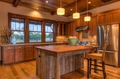Rustic style island kitchen nice and spacious love the lighting over the island. This kitchen has a real homely feel to it.  #kitchen #island #kitchenisland #breakfastbar #home #inspiration #diy #rustic  Image source: www.shudah.co.uk