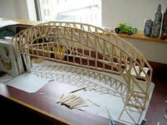 how to build a bridge out of popsicle sticks… I chose this because the bridge looks really nice while not requiring a lot of different materials. It seems like a pretty simple project but still fun. Popsicle Bridge, Popsicle Stick Bridges, Popsicle Stick Art, Popsicle Stick Crafts, Craft Stick Crafts, Crafts For Kids, Stem Projects, Science Projects, Bridge Design