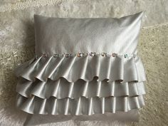 DIY Silver leather pillow with ruffles and rhinestone buttons