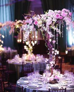 Chic #floral centerpiece pop at this elegant #teal #uplighting reception. Photo via #binaryflipphotography