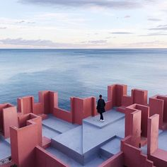 La Muralla Roja, Spanish for 'The Red Wall,' is a housing project located within the La Manzanera development in Spain's Calpe. Architect Ricardo Bofill. Photo by Nacho Rodríguez @naseke #yatzer_inspiration