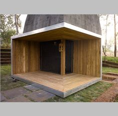 Shiv Temple by Sameep Padora & Associates. A wood-clad frame wraps around one corner marking the entrance, while the interior is illuminated by a skylight. Temple Architecture, Religious Architecture, Architecture Design, Pune, Tokyo Apartment, White Oak Tree, Basalt Stone, Garden Pavilion, Temple