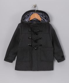 Adorable coat for boys!  This coat is a dapper pick, thanks to its wool blend and neat plaid lining. The toggle closures are a playful way to button up, and the collar snaps to keep in heat.90% polyester / 10% woolMachine wash; tumble dryImported