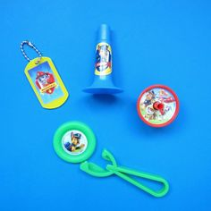 A selection of Paw Patrol themed party gifts, including a Paw Patrol horn, spinning top, flying disc shooter and dog tag £1 per set. https://littlepartyparcels.co.uk/shop/paw-patrol-party-filler/