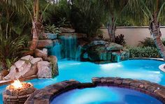 lagoon-looking pool with hot tub