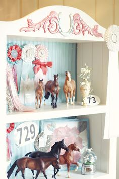 This bookcase would be beautiful as-is in any horse-crazy girl's room, but I think it would be equally stunning with a different color scheme in an adult equestrian's study. I want one!