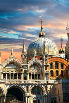 Facade with Gothic architecture and Romanesque domes of St Mark's Basilica in Venice Veneto, Italy