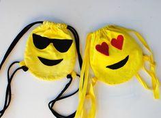 Emoji drawstring backpacks- 2 week project, felt, needle, thread, rope/ribbon