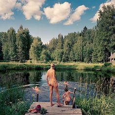 """How do families around the world spend their vacations? @nytmag explored that question over the weekend in its annual #NYTMagVoyages issue. This photograph, by Joakim Eskildsen, appeared on the cover. """"It's extremely rare for nudity to appear anywhere in this magazine, let alone on the cover,"""" wrote Jake Silverstein, @nytmag's editor in chief, """"but this picture neatly captured some of the themes of the issue: the joy of family and the world's abundant beauty — and also the jarring cultural…"""