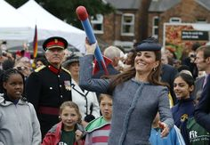 Pin for Later: Kate Middleton and Prince William's Most Precious Moments With Kids  She tried her hand at throwing a foam javelin when she attended a children's sports event at Vernon Park in Nottingham, England, in June 2012.