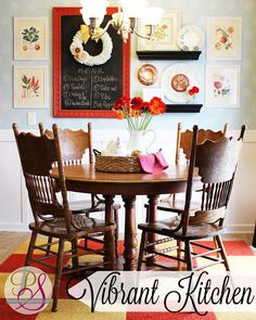 need to do something like this with the big blank wall in our kitchen!  also love the white pitcher with flowers and all the red details.  :o)