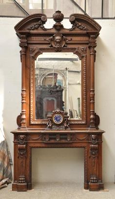 antique oak wood Napoleon III style fireplace with lion heads decoration