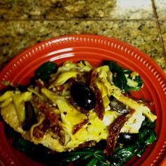 Lynda's Mediterranean chicken Chicken Breast  Artichoke Hearts Black Olives Sun Dried Tomatoes on spinach