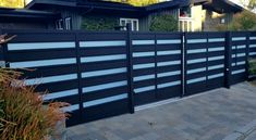 Tandem Sliding Gate - A complicated installation, but the end result was well worth it! This tandem sliding is acco - House Fence Design, House Main Gates Design, Front Gate Design, Door Gate Design, Garage Door Design, Modern Garage Doors, Gate Designs Modern, Modern Fence Design, Modern Gates