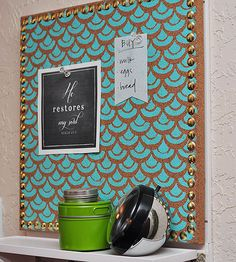When Amy of Delineate Your Dwelling was looking for a way to organize her mail, sunglasses, and on-the-go lists, she found a near-perfect wall manager system at her local office supply store. However, its uninspiring design stuck out like a sore thumb in her colorfully decorated home, so the crafty blogger got to work customizing the store-bought message center.