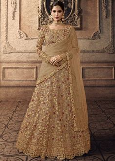 Beige net semi stitch lehenga with net choli. This lehenga choli is embellished with resham, stone and dori work. Product are available in 32 to 58 sizes. It is perfect for Bridesmaid Wear, Guest of Wedding Wear, Party Wear, Wedding Wear. Lehenga Anarkali, Lehenga Choli Online, Bridal Lehenga Choli, Indian Lehenga, Silk Lehenga, Lehenga Top, Anarkali Suits, Lehenga Wedding, Sharara Suit