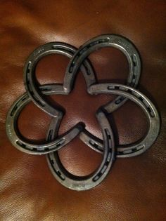 Five horseshoes overlapped, tacked then welded together at all points of crossing.