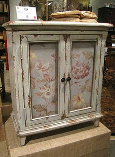 Country-cute floral fabric accent chest which incorporated fabric panels into a worn wood painted finish.