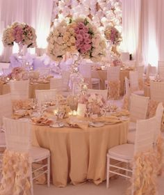 Love the soft colors and elaborate center pieces!