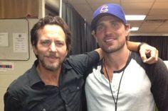 Pearl Jam lead singer Eddie Vedder with Chicago Blackhawks Patrick Sharp