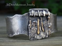 Sterling silver and gold fused and reticulated cuff $165.00 by JoDeneMoneuseJewelry on Etsy