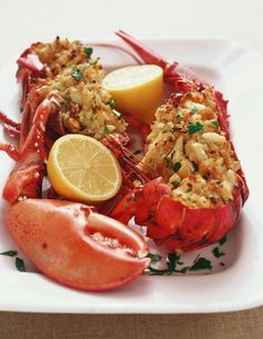 Baked Stuffed Lobster with Crab Meat and Bread Crumb Stuffing Garnished with Lemon Halves - Joseph De Leo / Getty Images Lobster Dishes, Fish Dishes, Seafood Dishes, Fish And Seafood, Fish Recipes, Seafood Recipes, Cooking Recipes, Baked Lobster Recipes, Baked Stuffed Lobster
