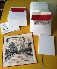 These invitations are made on the back of vintage handkerchiefs. very inventive. lovely
