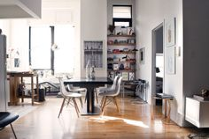 Brooklyn Loft by Lathan Boyce. Dining space features BoConcept table, Eames Chairs, Le Corbusier LC1 Sling Chair, Eileen Gray Side Table, and Gunther Lambert Floor Lamp.