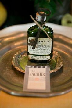 Whiskey Bottle and Vintage Key Place Cards | Erin Johnson Photography | Iron and Velvet Romantic Steampunk Wedding